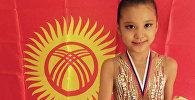 Кыргызстандык жаш гимнаст Эдел Касенова. Архивдик сүрөт
