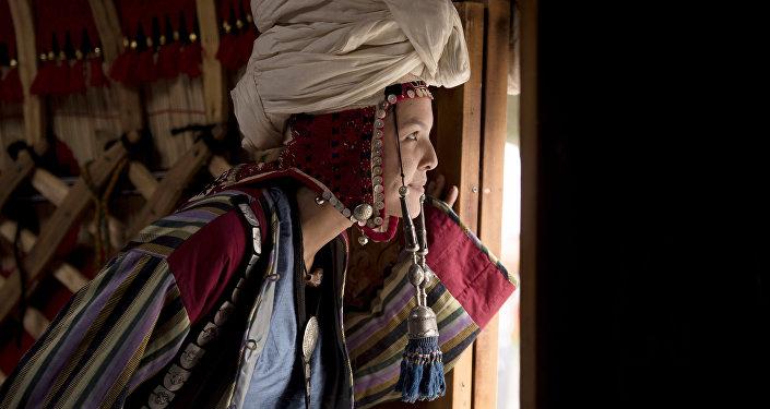 Оймо фестивалынын катышуучусу. Архив