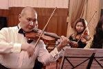 Дүйнө тасмаларындагы мыкты музыкалар кыргыз оркестринин аткаруусунда