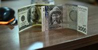 Национальная и долларовая купюра. Архивное фото