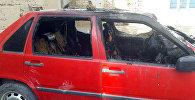Последствие пожара внутри салона автомобиля, где получил ожог ребенок двух лет в селе Жаны-Арык Ноокенского района