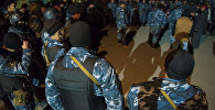Сотрудники МВД во время оперативно-разыскных работ. Архивное фото