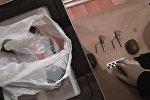 Россияда теракт жасоого аракет кылып кармалгандардан табылган курак жарак. Архивдик сүрөт