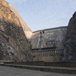 Токтогул ГЭСинин плотинасынын бийиктиги 215 метр, узундугу 292 метрди түзөт