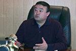 Сузак айыл өкмөтүнүн башчысы Аскарбек Сариевдин архивдик сүрөт