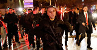 Турецкая полиция возле картинной галереи, где было нападение на посла России в Турции Андрея Карлова