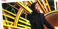 Выступление кыргызского певца Кайрата Примбердиева на шоу проекте Голос. Фото с сайта Youtube