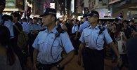 Кытай полициясы көзөт кезинде. Архивдик сүрөт