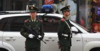 Кытай полиция кызматкерлери. Архивдик сүрөт
