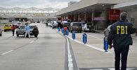 Сотрудник правоохранительный органов на месте стрельба в аэропорту Форт-Лодердейл во Флориде