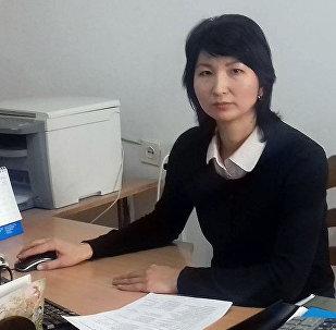 Архивное фото сотрудницы пресс-службы Министерства труда и социального развития Кымбат Кадыралиевой