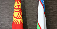 Флаги Кыргызской Республики и Узбекистана. Архивное фото