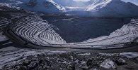 Карьер по обогащению золотоносной руды добываемой на руднике Кумтор. Архивное фото