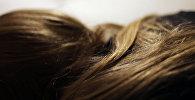Волосы девушки. Архивное фото