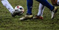 Футбол ойногондор. Архивдик сүрөт