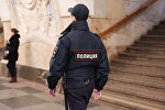 Сотрудник полиции на станции метро. Архивное фото