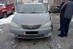 Автомобиль марки Toyota Camry на котором был совершен автонаезд на двух женщин в Бишкеке