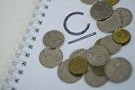 Официальной графический символ денежной единицы сома, утвержденный Национальным банком КР и монеты