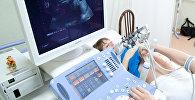 Ультразвуковое исследование беременной женщины. Архивное фото