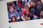 Снимок с видеохостинга Youtube канала Just Videos. Девушка целуется с парнем в перерыве спортивного соревнования