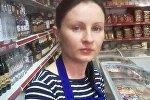 Казакстандагы дүкөндөрдүн биринин сатуучусу Нина Калимованын архивдик сүрөтү