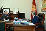Президент Кыргызской Республики Алмазбек Атамбаев в ходе встречи с министром внутренних дел Уланом Исраиловым