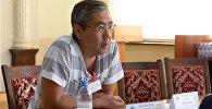 Архивное фото казахстанского экономиста, директора консалтинговой компании Айдархана Кусаинова