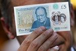 Англиянын банкы жаңы басып чыгарган 5 фунт номиналындагы банкноту. Архив