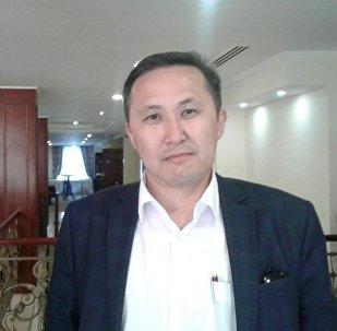 Маалыматтык технологиялар жана байланыш мамлекеттик комитетинин төрагасынын орун басары Эшмамбет Аматовдун архивдик сүрөтү