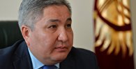 Жогорку Кеңештин Эл аралык иштер, коргоо жана коопсуздук боюнча комитети Болот Отунбаевдин архивдик сүрөтү