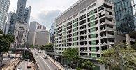 Здание многоуровневой парковки в Гонконге, проданное на аукционе компании Henderson Land. 17 мая 2017