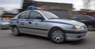 Милиция кызматкеринин автоунаасы. Архивдик сүрөт