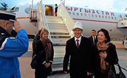 Президент Кыргызстана Алмазбек Атамбаев и первая леди Раиса Атамбаева во время визита во Францию. Архивное фото