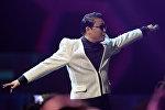 Южнокорейский исполнитель PSY во время выступления. Архивное фото