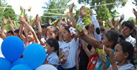 Балдарды коргоо эл аралык күнүнө карата Ош шаардык кеңешинин депутаттары Алымбек датка эс алуу багында майрамдык иш-чара уюштурушту