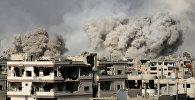 Дым после авиаударов в Сирии. Архивное фото
