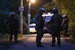 Кратово айылындагы полиция кызматкерлери. Архивдик сүрөт