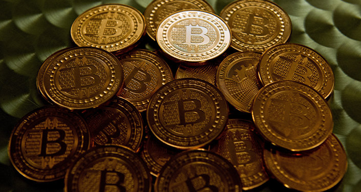 Монеты криптовалюты Биткойн. Архивное фото