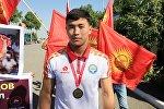 Кытайда өткөн Азия чемпионатында грек-рим күрөшү боюнча алтын медаль уткан Акжол Махмудовду Ошто салтанаттуу тосуп алышты