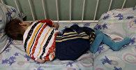 Ребенок на кровати. Архивное фото