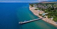Вид с высоты на пляж пансионата Аврора на Озере Иссык-Куль