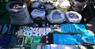 Изъятые вещи у задержанного по подозрению подготовки к совершению террористического акта члена МТО