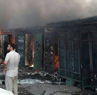 Последствия пожара на центральном рынке города Узген