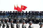 Военнослужащие на параде, посвященном 90-летию Народно-освободительной армии (НОАК), который прошел на крупнейшем военном полигоне страны Чжужихэ в автономном районе Внутренняя Монголия