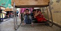 Сириянын Идлибтеги мектепте бомбалоо каршы сабак. Архивдик сүрөт