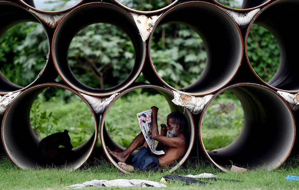 Индиядагы ысыктан кишилер колунан келишинче коргонууда