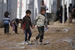 Иракские дети в лагере Хаммам аль-Алиль, к югу от Мосула. Архивное фото