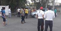 Потасовка между сотрудниками службы безопасности и продавцами на рынке Мадина