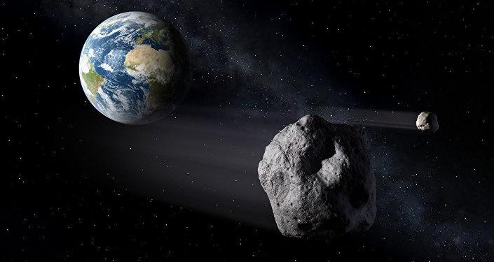 Астероид в космосе на фоне земли. Архивное фото