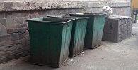 Мусорные контейнеры в которых был обнаружен обезглавленный труп женщины в Оше